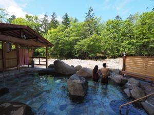 The swimming pool at or near Metou Onsen Hotel