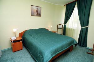 Кровать или кровати в номере Albatross