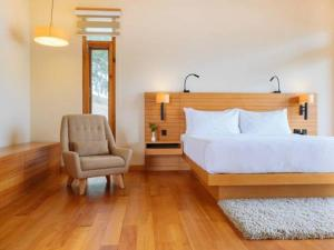 A bed or beds in a room at Dhensa Boutique Resort