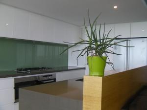 A kitchen or kitchenette at The Point Mandurah Apartment