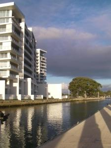 The swimming pool at or near The Point Mandurah Apartment