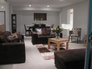 A seating area at The Point Mandurah Apartment