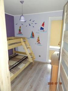 Łóżko lub łóżka piętrowe w pokoju w obiekcie Vanilla Apartment