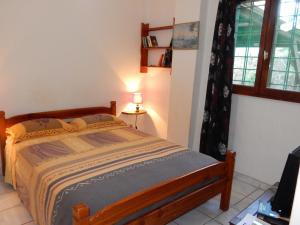 Un ou plusieurs lits dans un hébergement de l'établissement Sarl Mayoume