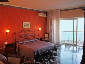 A bed or beds in a room at Costa Azzurra