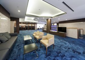 Area lobi atau resepsionis di Daiwa Roynet Hotel Toyama