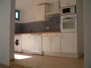 A kitchen or kitchenette at Domaine Du Bossu