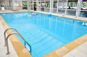 The swimming pool at or near Hotel Mura