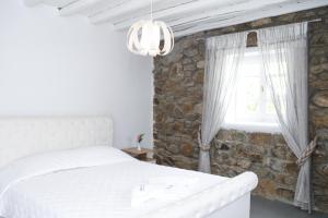 Ένα ή περισσότερα κρεβάτια σε δωμάτιο στο Anamar Blu