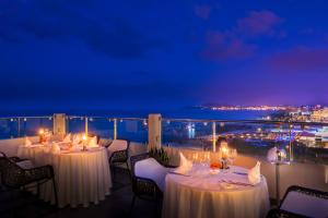 A restaurant or other place to eat at Elysium Resort & Spa