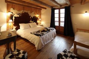 Un ou plusieurs lits dans un hébergement de l'établissement Auberge du Moulin de Léré