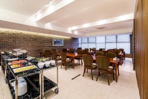 A restaurant or other place to eat at Korea Tourist Hotel