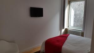 A bed or beds in a room at Casa das Boticas