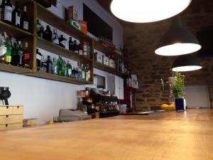 The lounge or bar area at La Hoja de Roble