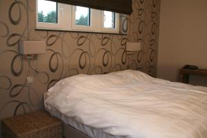 Un ou plusieurs lits dans un hébergement de l'établissement Hotel L'Ami du Chambertin