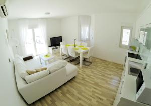 A seating area at Apartments & Rooms Barbati
