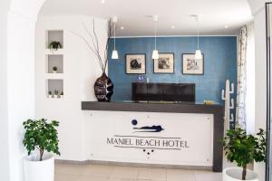 The lobby or reception area at Maniel Beach Hotel