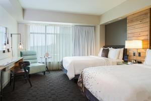 A bed or beds in a room at Renaissance Allentown Hotel