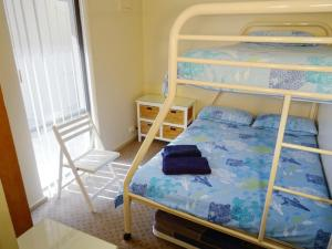 A bunk bed or bunk beds in a room at Scarborough & Absolutely Beachfront