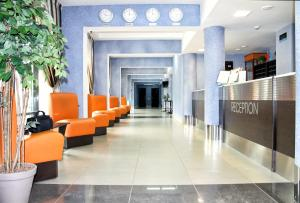 The lobby or reception area at East Time Hotel