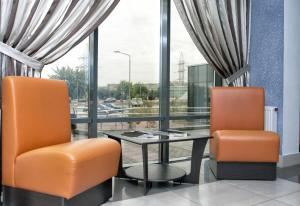 A seating area at East Time Hotel