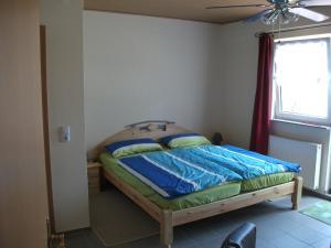 """Ein Bett oder Betten in einem Zimmer der Unterkunft """"Gästezimmer im Reich der Götter"""""""