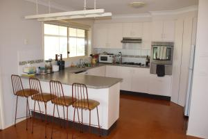 A kitchen or kitchenette at Waterfall Way Farmstay