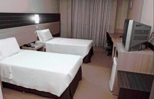 A bed or beds in a room at Hotel Executive Arapongas