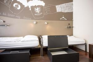 A bed or beds in a room at Sophie's Hostel
