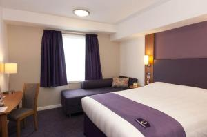 A bed or beds in a room at Premier Inn Dublin Airport