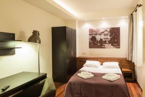 A bed or beds in a room at Vila Wendy