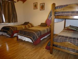 A bunk bed or bunk beds in a room at La Posta Apart