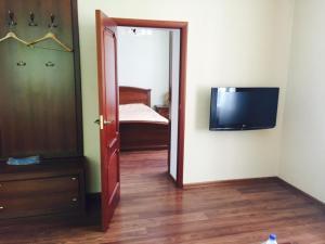 Кровать или кровати в номере Гостевой Дом у Каштана