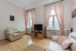 Телевизор и/или развлекательный центр в Apartment Fontanki 77