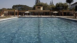 The swimming pool at or near Curia Palace, Hotel Spa & Golf