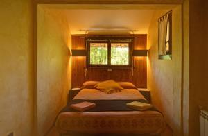A bed or beds in a room at EL Balcó de Dorres