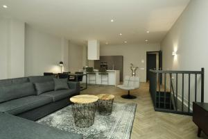 Coin salon dans l'établissement Stayci Serviced Apartments Westeinde