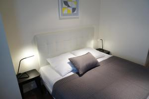 A bed or beds in a room at Hotel Zora