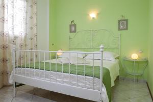 A bed or beds in a room at Apartments Talija