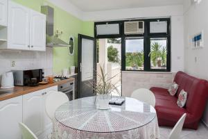 A kitchen or kitchenette at Apartments Talija