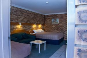A bed or beds in a room at Mid Town Inn Narrabri
