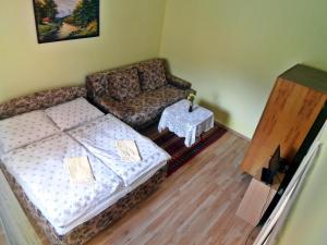 Posteľ alebo postele v izbe v ubytovaní Apartmán Magdaléna