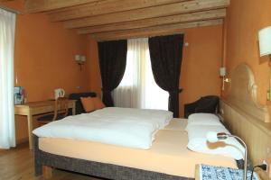 Postel nebo postele na pokoji v ubytování Bio Hotel Villa Cecilia