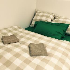 Un ou plusieurs lits dans un hébergement de l'établissement Appartement Blumenstrasse
