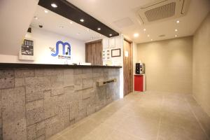 The lobby or reception area at Myeongdong Mom House