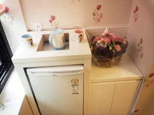 A kitchen or kitchenette at Myeongdong Mom House