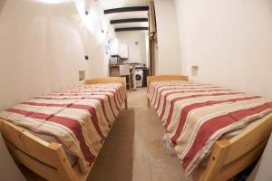 Кровать или кровати в номере Studio Grivtsova, 13