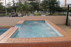 The swimming pool at or near Barbados Holiday Apartments