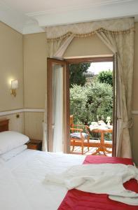 Кровать или кровати в номере Hotel Relais Patrizi