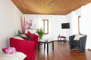 Ein Sitzbereich in der Unterkunft Cèc & Evita